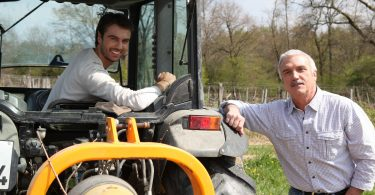 father and son working vineyard