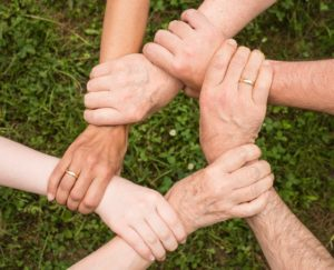 family holding hands in star shap