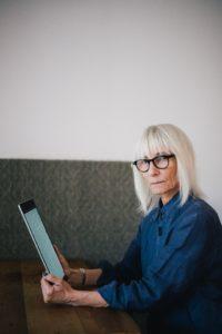 older lady reading a digital newspaper