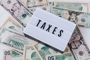 taxes sign for beneficiary