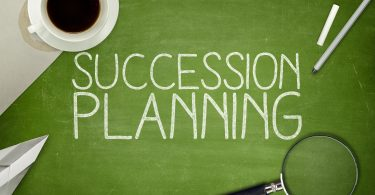 Succession planning concept on blackboard